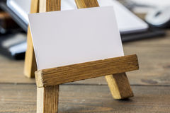 Small wooden easel with paper stock images