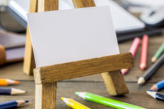 Small wooden easel with paper Stock Image