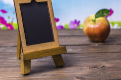 Small wooden easel on a table Royalty Free Stock Photos