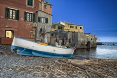 Small wooden fishing boat on the beach stock photos
