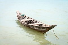 Small wooden fishing boat. In calm water Stock Photos