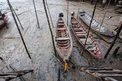 A small wooden fishing boat is run aground on the Stock Photo