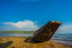 Wood boat on the coast Stock Photography