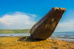 Wood boat on the coast Stock Images