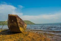 Wood boat on the coast Royalty Free Stock Photos