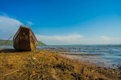 Wood boat on the coast Royalty Free Stock Photography