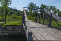 Small foot bridge over a stream Royalty Free Stock Image
