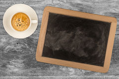 Small wooden framed blackboard with cup of coffee Royalty Free Stock Image