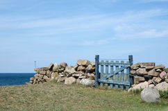 Small wooden gate by the coast Royalty Free Stock Photo