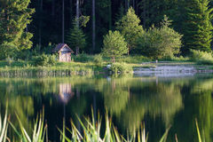 Small wooden house in Ain river at Champagnole, Jura, France Stock Images