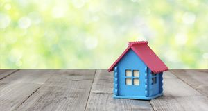 Small wooden house on blurred nature background. Stock Photos