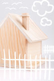 Small wooden house & children's drawings Royalty Free Stock Photo