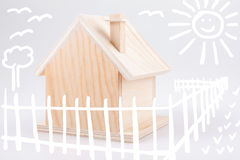 Small wooden house & children's drawings Stock Photos