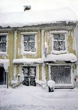 Small wooden house that is completely snow in royalty free stock photo