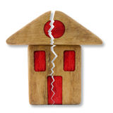 Small wooden house with a deep crack Royalty Free Stock Image