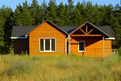 Small Wooden House. Ecological Small wooden house. Wooden house with meadow in front of it. Beautiful modern wooden house Stock Photography