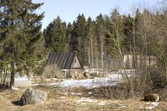 A small wooden house at the edge of a forest Stock Images