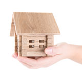 Small wooden house in a hand stock image