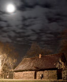 Small wooden house and moon Royalty Free Stock Photos