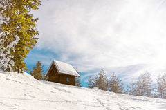Small wooden house on the mountain Stock Photo