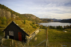 Small wooden house in the mountains Royalty Free Stock Images