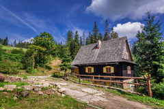 Small wooden house in the mountains Stock Photos
