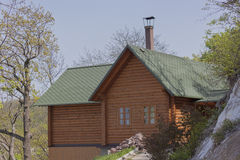 A small wooden house on a mountainside Royalty Free Stock Photo