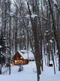 A small wooden house in snow forest Royalty Free Stock Photography