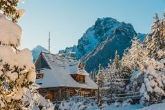 Wooden house in a snowy mountains. A small wooden house in a snowy mountains Stock Photo