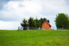 Small wooden house on the top of a hill Stock Photography