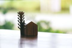 A small wooden house and tree model. On the table royalty free stock photos