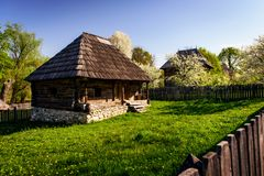 Small wooden house typical of vintage countryside of Romania. Small wooden cottage with old traditional rustic architecture in the countryside of Romania Stock Image