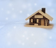 Small wooden house on the white fresh snow Royalty Free Stock Photos