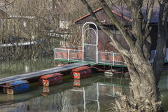 Small wooden houseboat with bridge Royalty Free Stock Photos