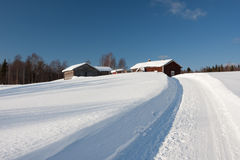 Small wooden houses in winter. Stock Photo