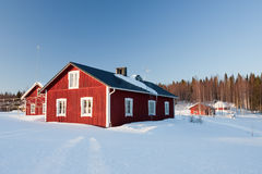 Small wooden houses in winter. Royalty Free Stock Photo