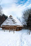 Small wooden houses in winter Royalty Free Stock Photos