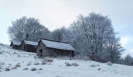 Small wooden houses in winter in the mountains. Stock Photography