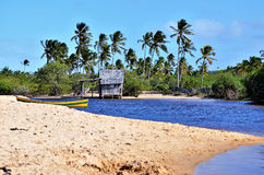 Small wooden hut. On a Brazilian coast beach surrounded by the small river bank in Trancoso in the city of Porto Seguro, Bahia, Brazil Royalty Free Stock Images