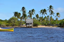 Small wooden hut. On a Brazilian coast beach surrounded by the small river bank in Trancoso in the city of Porto Seguro, Bahia, Brazil Royalty Free Stock Photography