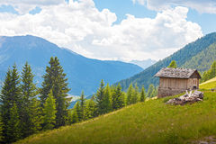 Small wooden hut in the Dolomites. Small wooden hut at Santa Maddalena Valley in the Dolomites Mountains, South Tyrol, Italy Stock Photos