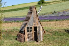 Small wooden hut in `Garden full of lavender` arranged by Barbara and Andrzej Olender in Ostrów 40 km from Krakow. Ostrow, Poland - June 6, 2018: Small stock images
