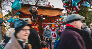 A small wooden hut or are sold Santa hats and balloons Stock Photos