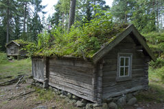 Small wooden huts with vegetation on roofs, Finland Stock Photos