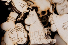 Small wooden images of the Moomims - Mumintroll - in selective focus. KYIV, UKRAINE - JUN 4: Small wooden images of the Moomims - Mumintroll - in selective focus Royalty Free Stock Photo