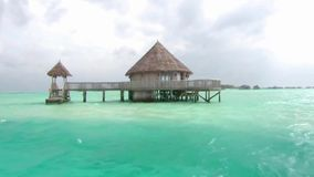 Tiny wooden luxury resort bungalow hotel apatment in turquoise ocean water tropical paradise at Maldives island seascape. Small wooden luxury resort bungalow stock video