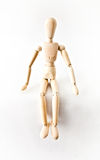 Wooden mannequin. Small Wooden mannequin on a white background royalty free stock photography