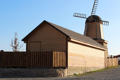 Small wooden mill. Clear sky Stock Photos
