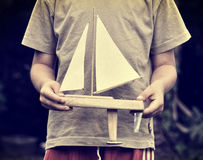 Small wooden model sailboats - toy Stock Photo