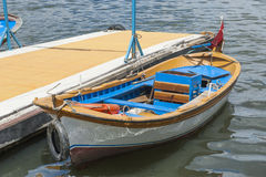 Small wooden motor boat moored up Stock Photography